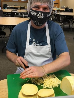 Employee chopping onions.